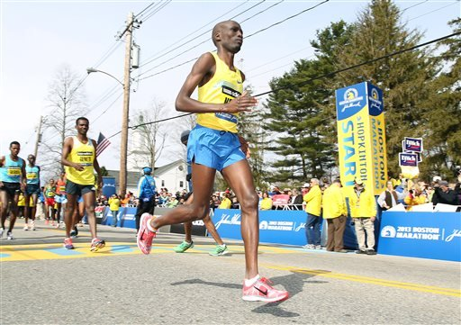 In this April 15, 2013, file photo, Wesley Korir, of Kenya, warms up prior to the start of the 117th running of the Boston Marathon, in Hopkinton, Mass. Korir had recently been elected to Parliament in his native Kenya. (AP Photo/Stew Milne, File)