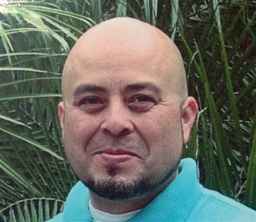 This June, 2013 photo released by the Hernandez family Saturday, Nov. 2, 2013, shows Transportation Security Administration officer Gerardo Hernandez.