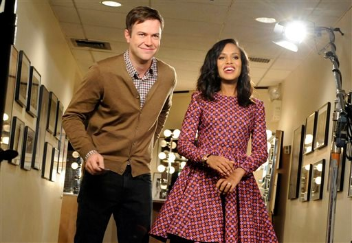 """This Oct. 29, 2013 photo released by NBC shows actress Kerry Washington, right, with cast member Taran Killam during a promotional shoot for """"Saturday Night Live,"""" in New York. Washington will host the late night comedy sketch series on Nov. 2."""