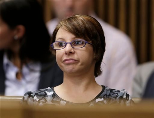 In this Thursday, Aug. 1, 2013 file photo, Michelle Knight sits in the courtroom during the sentencing phase for Ariel Castro in Cleveland.