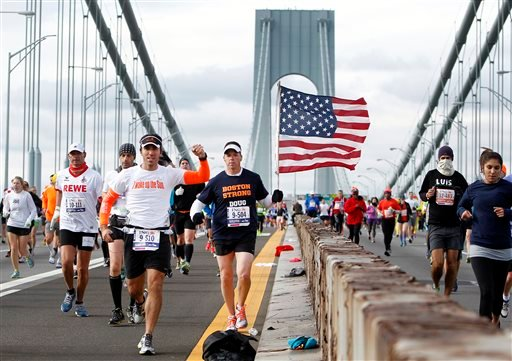Runners cross the Verrazano-Narrows Bridge at the start of the New York City Marathon, Sunday, Nov. 3, 2013, in New York. (AP Photo/Jason DeCrow)