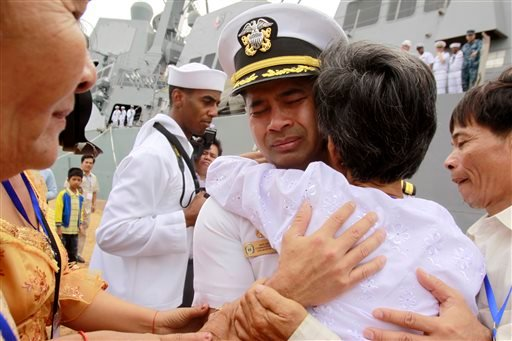 "In this photo taken Dec. 3, 2010, U.S. navy officer Michael ""Vannak Khem"" Misiewicz becomes emotional as he embraces his aunt Samrith Sokha, 72, at Cambodian coastal international see port of Sihanoukville, Cambodia."