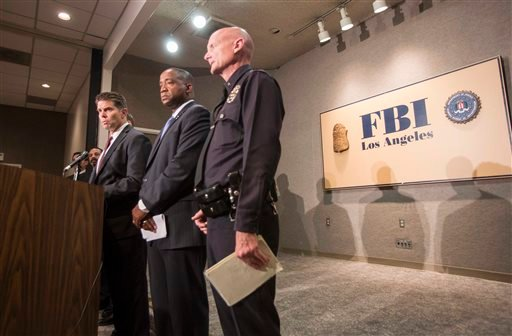 From left to right, FBI Special Agent in Charge David L. Bowdich, United States Attorney Andre Birotte Jr., and Los Angeles Police Department Commander Andrew Smith in press conference to provide an update on the investigation of the shooting incident.