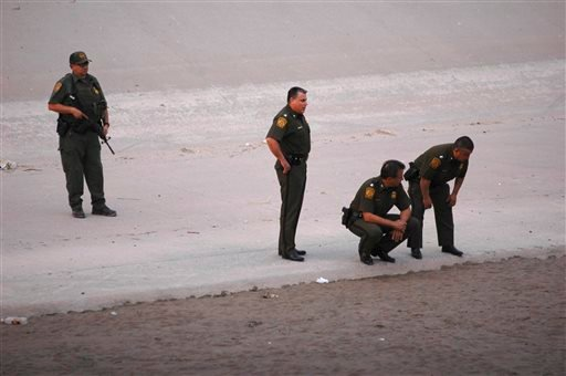 In this June 7, 2010, U.S. border patrol agents examine the area near where 14-year-old Mexican youth Sergio Adrian Hernandez Huereca was killed, allegedly shot by a U.S. Border Patrol agent after a confrontation under the Paso Del Norte border bridge.