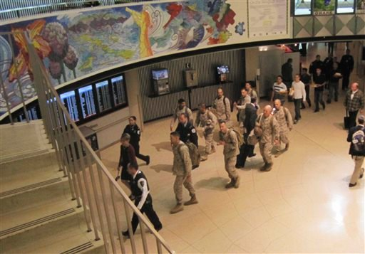 This Monday, Nov. 4, 2013 photo provided by American Airlines shows a group of Marines walking through a terminal at Chicago's O'Hare International Airport during part of their journey back home after a tour of duty in Afghanistan.