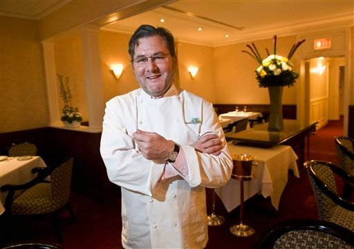 In this Dec. 30, 2011 photo, renowned chef Charlie Trotter poses for a photo in the dining room of his restaurant in Chicago.