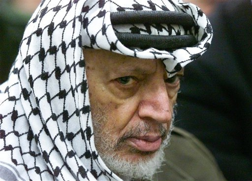 In this May 31, 2002 file photo, Palestinian leader Yasser Arafat pauses during the weekly Muslim Friday prayers in his headquarters in the West Bank city of Ramallah. (AP Photo/Lefteris Pitarakis, File)