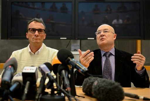 Swiss professor Francois Bochud, left, director of the Chuv Radiophysics Institute, IRA, and Swiss professor Patrice Mangin, right, director of the University Center of Legal Medicine in Lausanne, CURML, speak on a forensics report. (AP)