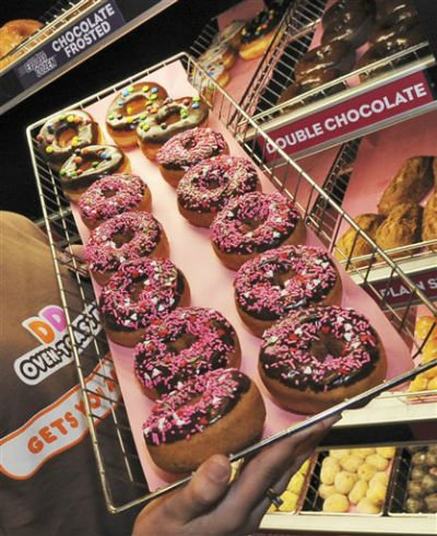 In this Feb. 12, 2008 file photo, a rack of donuts is displayed at a Dunkin' Donuts franchise in Boston.