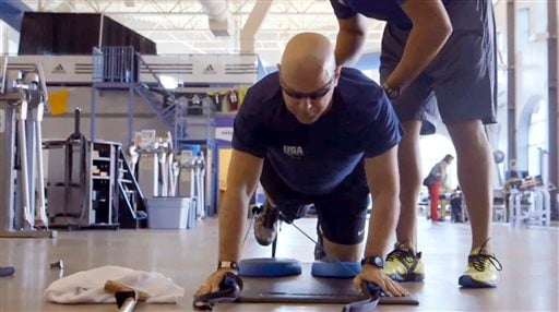 In this undated photo made from video and provided by Athletes Performance, U.S. Air Force, Chief Master Sgt. Damian Orslene works out in Gulf Breeze, Fla. (AP Photo/Athletes Performance)