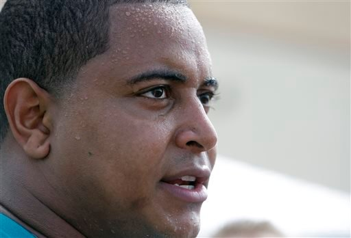 In this July 22, 2013, file photo, Miami Dolphins tackle Jonathan Martin in interviewed after an NFL football practice in Davie, Fla.