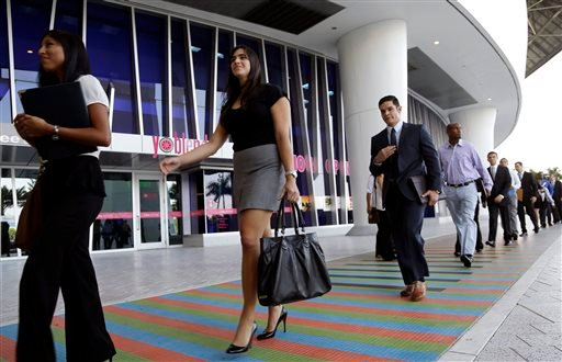 In this Wednesday, Oct. 23, 2013, file photo, job applicants arrives for an internship job fair held by the Miami Marlins, at Marlins Park in Miami.