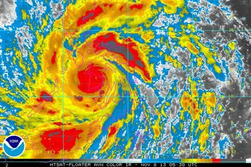 In this image provided by NOAA Friday Nov. 8, 2013 which was taken at 12:30 a.m. EST shows Typhoon Haiyan as it crosses the Philippines.