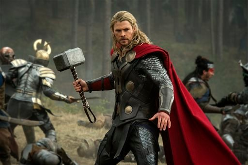 "This publicity photo released by Walt Disney Studios and Marvel shows Chris Hemsworth in a scene from ""Thor: The Dark World."" (AP Photo/Walt Disney Studios/Marvel, Jay Maidment)"