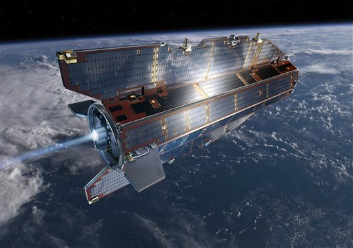 In his image, publicly provided by the European Space Agency ESA, research satellite GOCE flies above earth at unknown date.