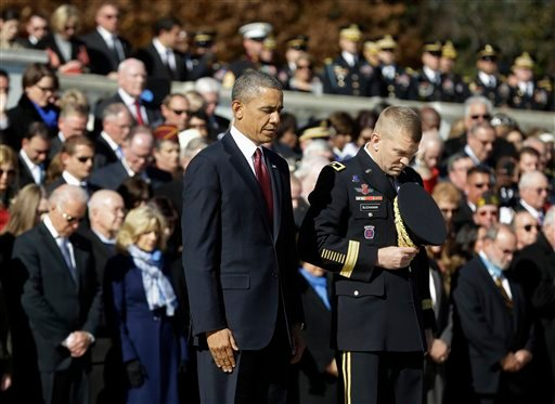 President Barack Obama and Maj. Gen. Jeffrey S. Buchanan of the U.S. Army Military District of Washington, left, lower their heads after the president placed a wreath at the Tomb of the Unknowns at Arlington National Cemetery in Arlington, Va. (AP)