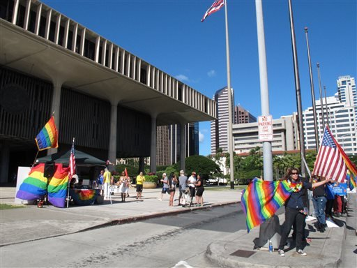 Gay marriage supporters rally outside the Hawaii Capitol in Honolulu ahead of a Senate vote on whether to legalize same-sex marriage on Tuesday, Nov. 12, 2013. (AP)