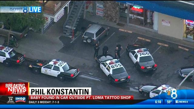 Police on scene at a Point Loma strip mall, where a baby was left alone inside the silver Toyota RAV4 (seen in this video screen image).