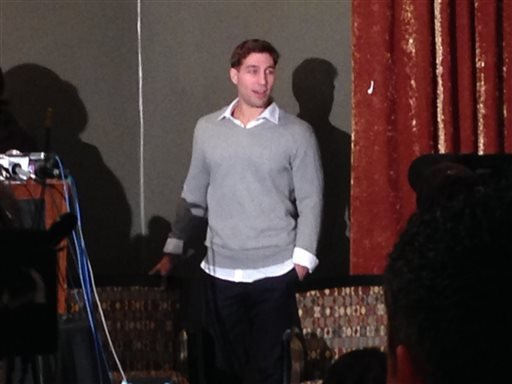 Ryan Ferguson arrives Tuesday night, Nov. 12, 2013, at the Tiger Hotel, in Columbia, Mo., to speak to supporters after being freed from prison earlier in the evening. (AP Photo/David A. Lieb)