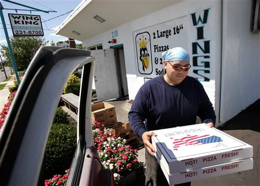 FILE - In this Wednesday, Aug. 24, 2005, file photo, delivery driver Teddy Munz, of Williamstown, N.J., loads a food order at the WingKing resturant into his pick-up truck for delivery in Moorestown, N.J. (AP)