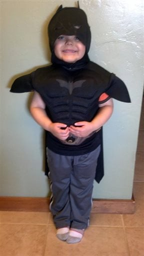 This undated image released by Make-A-Wish Greater Bay Area, shows five-year-old Miles Scott dressed as batman.
