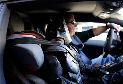 """Miles Scott, 5, dressed as Batkid, waits in a Lamborghini """"Batmobile"""" as he and Batman get ready to stop a bank robbery in San Francisco, Friday, Nov. 15, 2013. (AP)"""