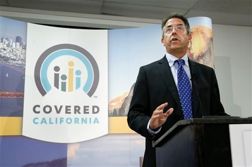In this photo taken Wednesday, Nov. 13, 2013, Peter Lee, executive director of Covered California, the state's health insurance exchange, announced that nearly 35,000 people signed up for health insurance during the first month of open enrollment.