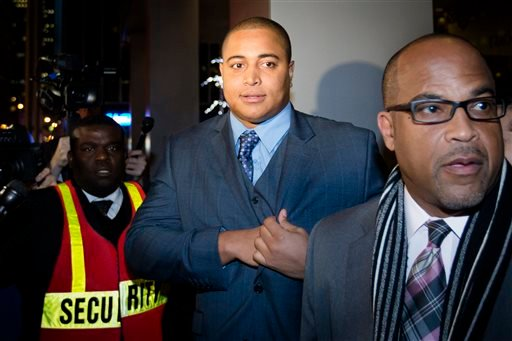 Miami Dolphins lineman Jonathan Martin, center, prepares to speak to members of the media outside the office of the NFL lawyer investigating the team's bullying scandal, Friday, Nov. 15, 2013, in New York.