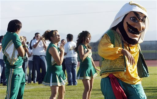 "In this Nov. 10, 2005 photo, Coachella Valley High School's mascot, ""Arab,"" dances to the band during a pep rally at the school in Thermal, Calif."