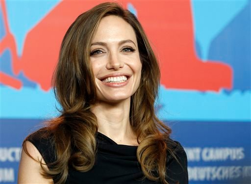 "In this Feb. 11, 2011 file photo, Director Angelina Jolie smiles during the press conference of the film ""In the Land of Blood and Honey,"" at the 62 edition of the Berlinale, International Film Festival in Berlin."