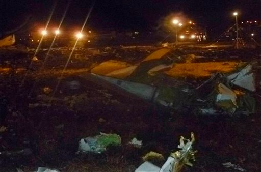 This photo provided by the Russian Emergency Situations Ministry shows debris at the crash site of the Russian passenger airliner, Boeing 737, near Kazan, the capital of the Tatarstan republic, about 450 miles east of Moscow, Sunday, Nov. 17. 2013.