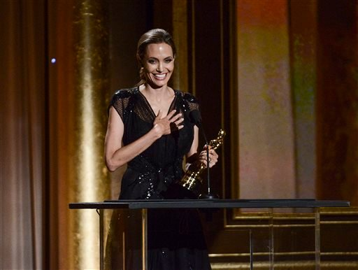 Actress and honoree Angelina Jolie accepts her award at the 2013 Governors Awards on Saturday, Nov. 16, 2013 in Los Angeles. (Photo by Dan Steinberg/Invision/AP)
