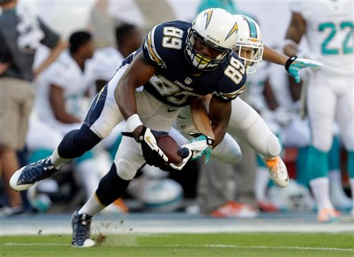 San Diego Chargers tight end Ladarius Green (89) grabs a pass over Miami Dolphins cornerback Brent Grimes during the first half of an NFL football game Sunday, Nov. 17, 2013, in Miami Gardens, Fla. (AP Photo/Lynne Sladky)