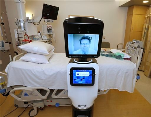 In this photo taken Wednesday, Nov. 6, 2013, Dr. Alan Shatzel, medical director of the Mercy Telehealth Network, is displayed on the monitor RP-VITA robot at Mercy San Juan Hospital in Carmichael, Calif.