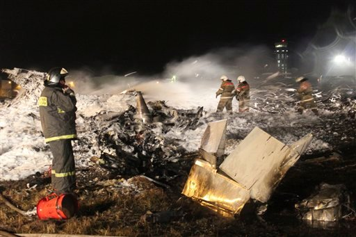 In this photo provided by Russian Emergency Situations Ministry fire fighters and rescuers work at the crash site of a Russian passenger airliner near Kazan, the capital of the Tatarstan republic, about 720 kilometers (450 miles) east of Moscow, Nov. 17.