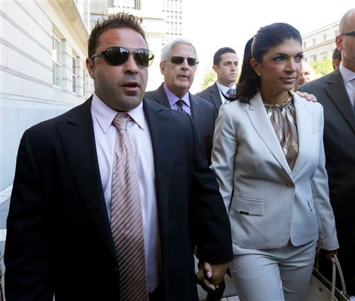 "FILE - In this July 30, 2013 file photo, ""The Real Housewives of New Jersey"" stars Giuseppe ""Joe"" Giudice, left, and his wife, Teresa Giudice, of Montville Township, N.J., walk out of Martin Luther King Jr. Courthouse after an appearance in Newark, N.J."