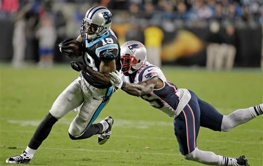 Carolina Panthers' Ted Ginn (19) runs past New England Patriots' Kyle Arrington (25) for a touchdown during the second half of an NFL football game in Charlotte, N.C., Monday, Nov. 18, 2013. The Panthers won 24-20. (AP Photo/Bob Leverone)