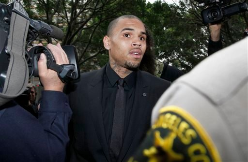 Singer Chris Brown arrives at court for a probation review hearing Wednesday, Nov. 20, 2013, in Los Angeles.