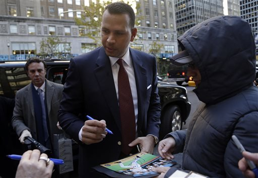 Alex Rodriguez signs autographs as he arrives at Major League Baseball headquarters in New York, Tuesday, Nov. 19, 2013. (AP)