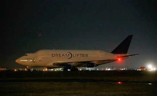 A Boeing 747 LCF Dreamlifter sits on the runway after accidentally landing at Col. James Jabara Airport in Wichita, Kan. Wednesday night Nov. 20, 2013. (AP Photo/Wichita Eagle, Jaime Green)