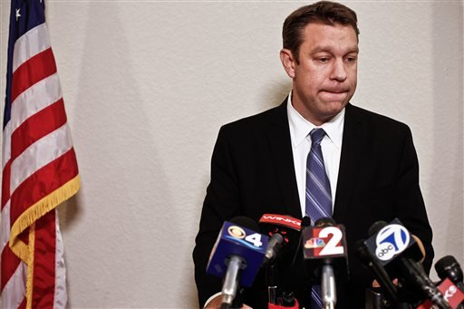 Congressman Trey Radel takes a moment to himself as he addresses the media at his office in Cape Coral on Wednesday night Nov. 20, 2013. (AP)