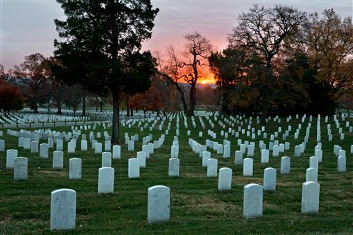 The sun rises over Arlington National Cemetery on the 50th anniversary of the death of President John F. Kennedy, Friday, Nov. 22, 2013. (AP Photo/Jacquelyn Martin)