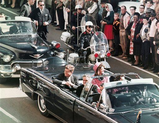 In this Nov. 22, 1963 file photo, President John F. Kennedy's motorcade travels through Dallas. (AP Photo/PRNewsFoto/Newseum, File)