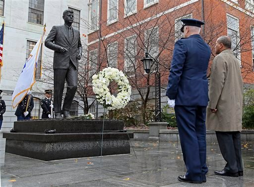 Gov. Deval Patrick, right, and L. Scott Rice, Adjutant General of the Massachusetts National Guard, lay a wreath at the State House statue of President John F. Kennedy, Friday, Nov. 22, 2013, in Boston. (AP)