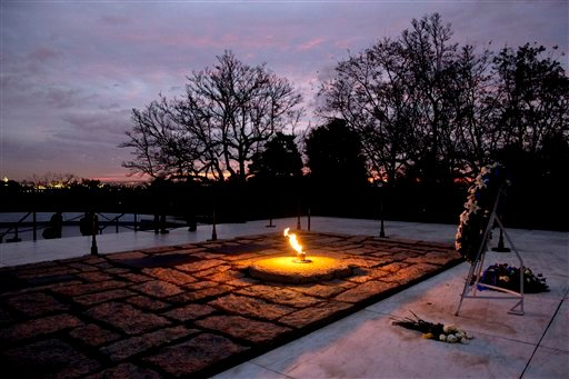 The eternal flame flickers in the early morning light at the grave of John F. Kennedy at Arlington National Cemetery on Friday, Nov. 22, 2013, on the 50th anniversary of Kennedy's death. (AP Photo/Jacquelyn Martin)