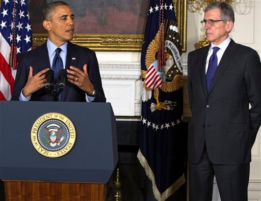 FILE - In this Wednesday, May 1, 2013, file photo, President Barack Obama announces his nominees for the Federal Communications Commission (FCC), Tom Wheeler, right. (AP)