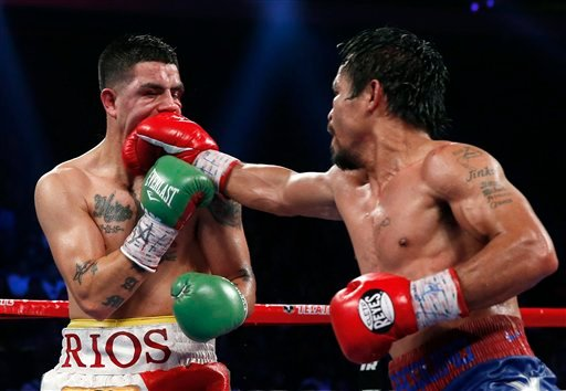 Manny Pacquiao, from the Philippines, right, lands a right to Brandon Rios of the United States.