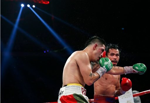 Manny Pacquiao from the Philippines, right, lands a right to Brandon Rios.