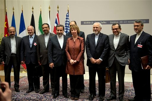 EU High Representative for Foreign Affairs and Security Policy Catherine Ashton, center, poses next to Iranian Foreign Minister Mohammad Javad Zarif, center right, and the Iranian delegation after a ceremony at the United Nations in Geneva, Switzerland.