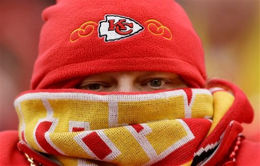 A Kansas City Chiefs fan watches during the final minutes of an NFL football game against the San Diego Chargers, Sunday, Nov. 24, 2013, in Kansas City, Mo. The Chargers won the game 41-38. (AP Photo/Charlie Riedel)